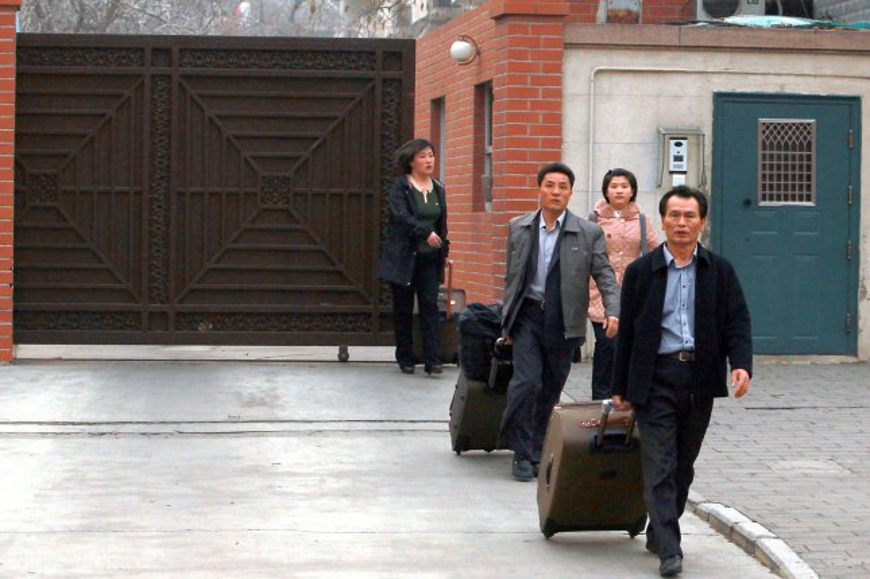 North Koreans leave the North Korean embassy in Beijing on March 22, 2013. (UPI/Stephen Shaver)