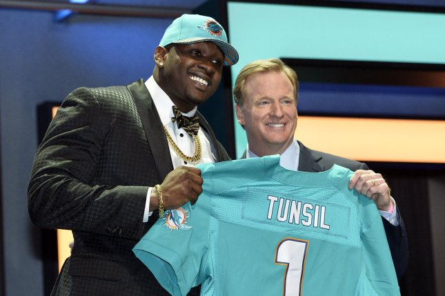 Ole Miss offensive tackle Laremy Tunsil poses with NFL Commissioner Roger Goodell after being selected by the Miami Dolphins with the 13th overall pick in the 2016 NFL Draft on April 28, 2016 in Chicago. Photo by Brian Kersey/UPI