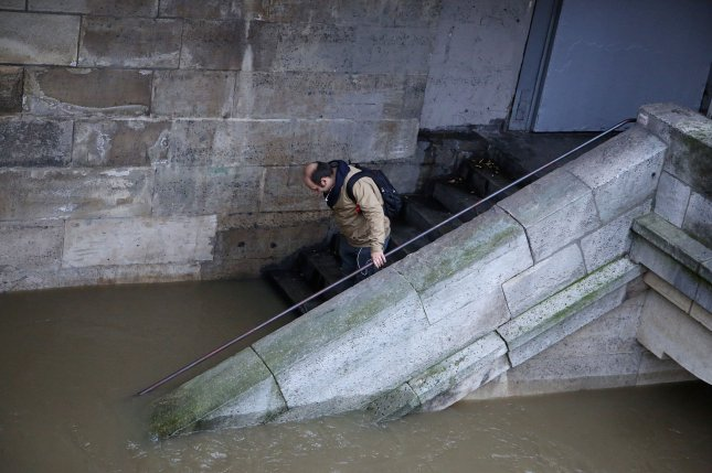 A man on a stairway is cut off by a rising Seine River in Paris on Thursday, June 2, 2016. The river has swollen to its highest level in 30 years and forced the closure of the Louvre and Orsay Museums, as well as some trains and metros. The flooding was the result of sustained rains that caused the Seine to rise to 18 feet above its normal level, as of Thursday, officials said. Photo by David Silpa/UPI