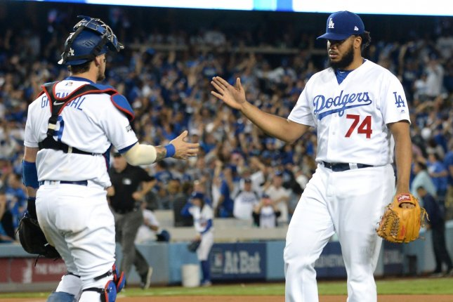 Los Angeles Dodgers pitcher Kenley Jansen (74) is congratulated by catcher Yasmani Grandal after the final out against the Chicago Cubs to end game 3 of the National League Championship Series at Dodger Stadium in Los Angeles, on October 18, 2016. Los Angeles won 6-0 and leads the series two games to one. Photo by Jim Ruymen/UPI