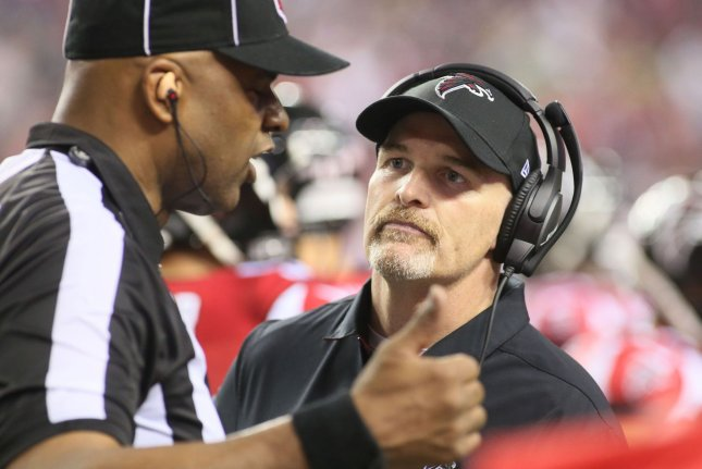 Atlanta Falcons head coach Dan Quinn talks with officials as he protested an incomplete pass call that was reversed, during their NFC playoff game against the Seattle Seahawks at the Georgia Dome in Atlanta on January 14, 2017. File photo by Phil Skinner/UPI