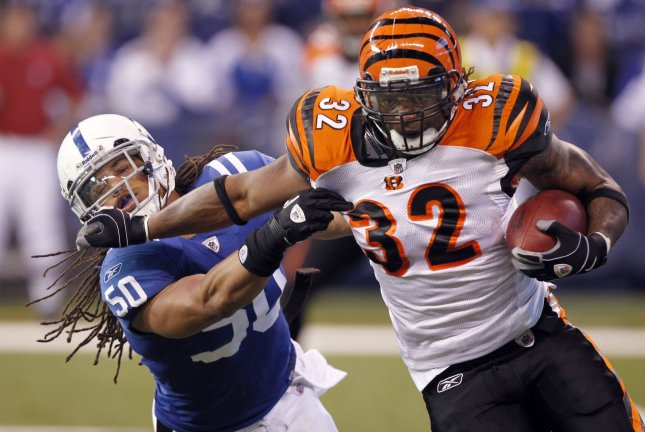 Former Cincinnati Bengals running back Cedric Benson (32) died Saturday night in a motorcycle crash. File Photo by Mark Cowan/UPI
