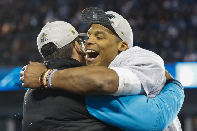 Former Carolina Panthers coach Ron Rivera (L) said he has considered a reunion with quarterback Cam Newton (R) in 2020 with the Washington Redskins. File Photo by Nell Redmond/UPI