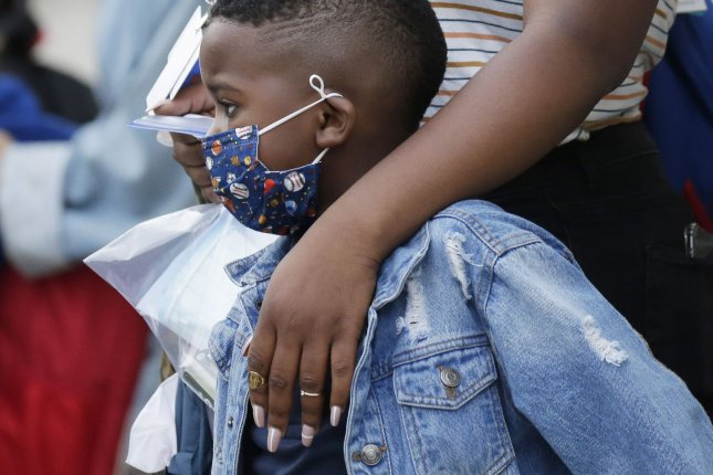 Schools and childcare facilities can remain open during the pandemic by implementing measures to limit COVID-19 spread, according to a new CDC analysis. Photo by John Angelillo/UPI