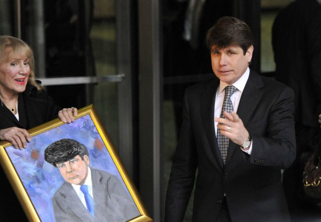 Former Illinois Gov. Rod Blagojevich leaves federal court as courtroom artist Verna Sadock holds a portrait she painted of him on April 21, 2011 in Chicago. With his first trial ending last year with jurors deadlocked on all but one count, Blagojevich now faces 20 charges in a simplified case where prosecutors dropped complex charges over concerns that the jury would not be able to follow the evidence. UPI/Brian Kersey