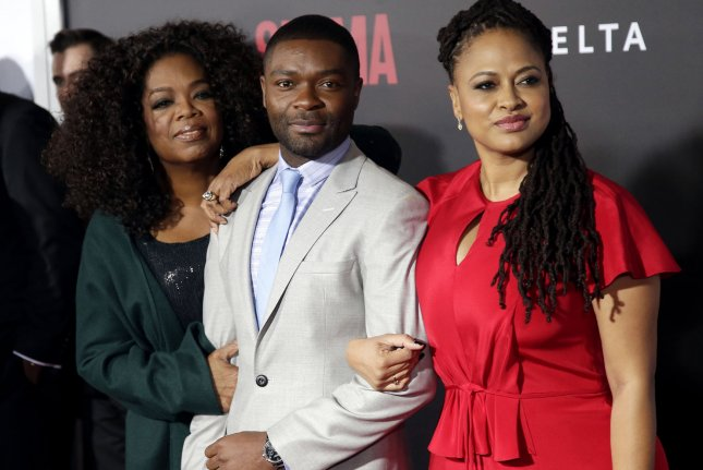 Oprah Winfrey, David Oyelowo and Ava Duvernay arrive on the red carpet at the New York Premiere of 'Selma' at Ziegfeld Theater in New York City on December 14, 2014. UPI/John Angelillo