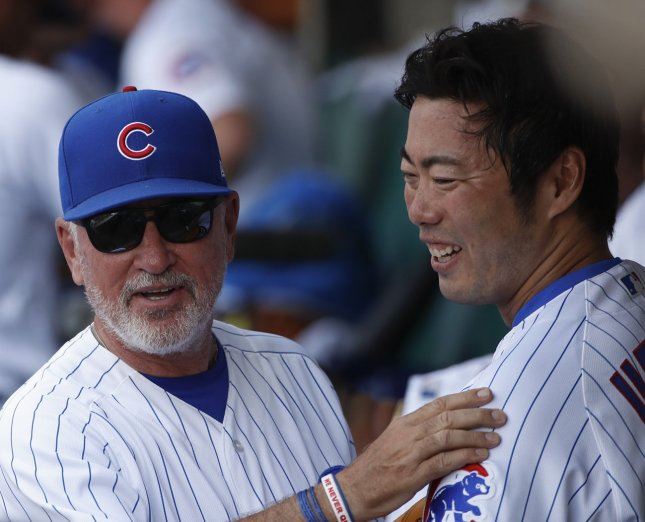 Chicago Cubs manager Joe Maddon (L) talks in a dugout with relief pitcher Koji Uehara. Photo by Kamil Krzaczynski/UPI