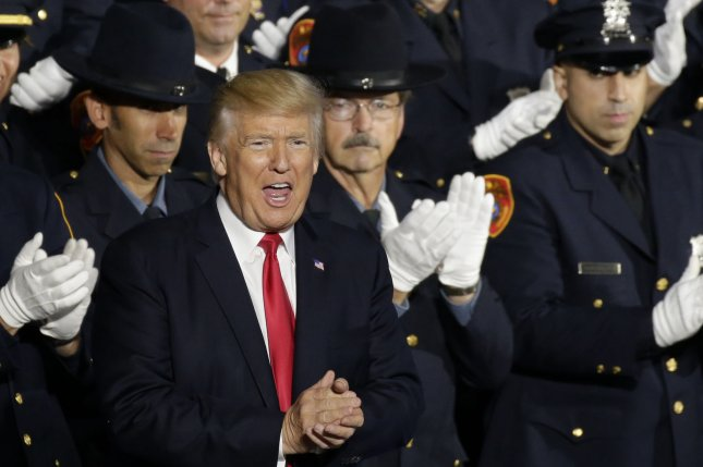 President Donald Trump arrives to deliver remarks on MS-13 to federal, state and local law enforcement at the Van Nostrand Theatre at Suffolk County Community College in Brentwood, N.Y., on Friday. Photo by John Angelillo/UPI