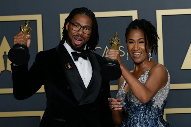 Matthew A. Cherry and Karen Rupert Toliver, winners of Animated Short Film for Hair Love, appear backstage with their Oscars in Los Angeles on February 9. The film inspired an HBO Max series called Young Love. File Photo by John Angelillo/UPI