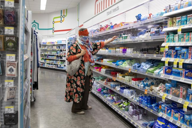 A shopper wears a face covering at a Walgreens location in Washington, D.C., on April 24. File Photo by Tasos Katopodis/UPI