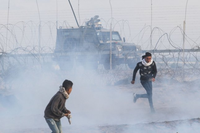 Israeli security forces fire teargas during clashes with Palestinian protesters during a demonstration along the border with Israel east of Rafah in the southern Gaza strip on December 27, 2019. File Photo by Ismael Mohamad/UPI