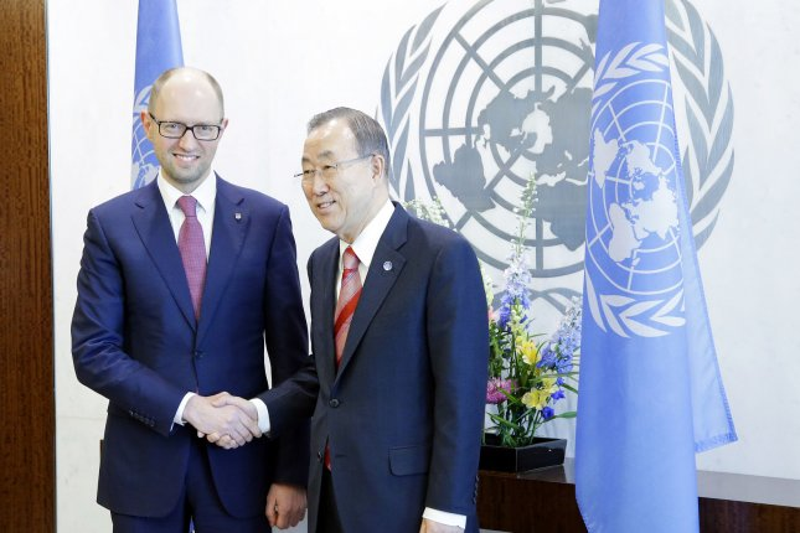 Prime Minister of Ukraine Arseniy Yatsenyuk shakes hands with Secretary-General Ban Ki-moon at the United Nation headquarters UN Building in New York City on March 13, 2014. (UPI/John Angelillo)