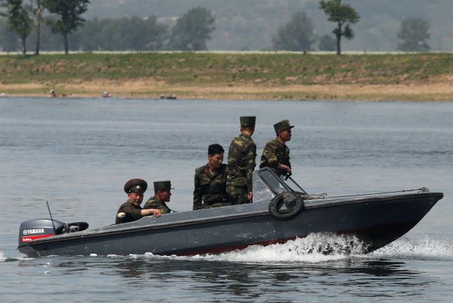 """North Korean soldiers patrol the banks of the Yalu River near Sinuiju, across the Yalu River from Dandong, China's largest border city with North Korea. Pyongyang said Wednesday its hydrogen bomb was developed in response to a hostile""""U.S. policy. File Photo by Stephen Shaver/UPI"""