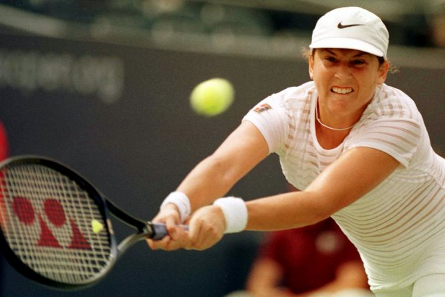Monica Seles reaches as she returns a serve from Annie Miller during her U.S. Open match on September 4, 1998. Seles won 6-3, 6-3. File Photo by Ezio Petersen/UPI