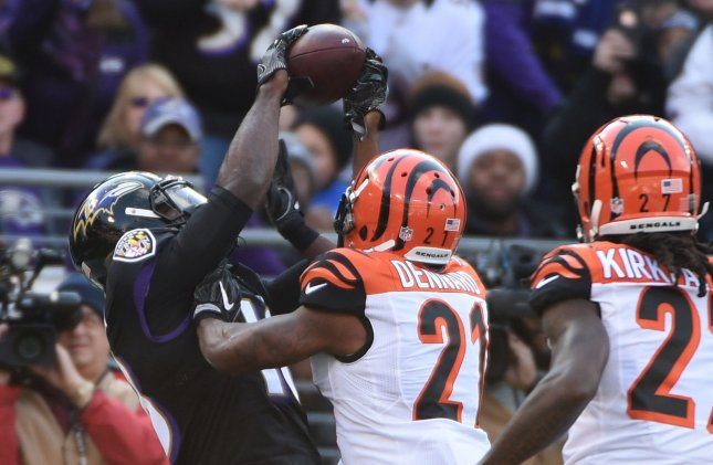 Baltimore Ravens wide receiver Breshad Perriman catches an 18-yard touchdown pass in front of Cincinnati Bengals cornerbacks Darqueze Dennard (21) and Dre Kirkpatrick (27) during the first half of their NFL game at M&T Bank Stadium in Baltimore, Maryland, November 27, 2016. Photo by David Tulis/UPI
