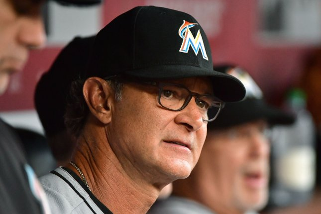 Miami Marlins manager Don Mattingly sits in the dugout as his team plays the Washington Nationals on July 6 at Nationals Park in Washington, D.C. Photo by Kevin Dietsch/UPI
