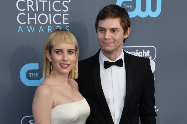 Emma Roberts (L), pictured with Evan Peters, has reportedly ended her engagement to the actor. File Photo by Jim Ruymen/UPI
