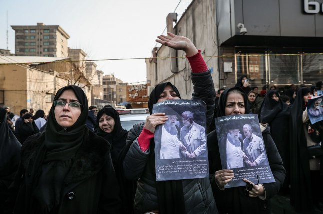 Thousands of Iranian mourners gathered around the coffins of Iranian Revolutionary Guards Commander Qassem Soleimani to pay tribute during his funeral in Tehran on January 6. Photo by Majid Asgaripour/UPI