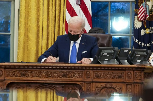 President Joe Biden signs executive orders to reform the U.S. immigration system Tuesday. Pool Photo by Doug Mills/UPI
