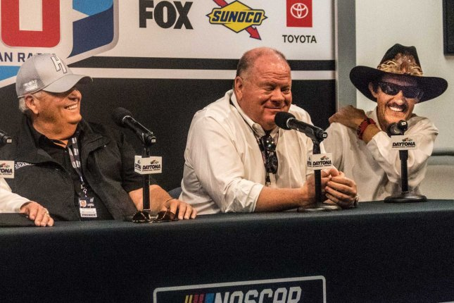 NASCAR team owner Chip Ganassi (C) cannot attend the next Cup Series race Sunday in Homestead, Fla., due to a suspension for violating NASCAR's COVID-19 protocol. File Photo by Edwin Locke/UPI