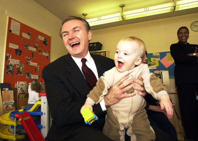 SLP2001020209 - 02 FEBRUARY 2001 - KIRKWOOD, MISSOURI, USA: Missouri Governor Bob Holden laughs as he picks up a smiling one-year-old Jack Adams, while touring the Kirkwood Early Childhood Center, in Kirkwood, Missouri, February 2, 2001. Holden has pledged an addition $7 million for support of the Parents as Teachers program that was devised in Missouri and has now spread nationwide. rlw/bg/Bill Greenblatt UPI