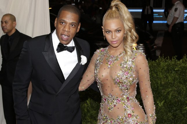 Jay Z and Beyonce arrive on the red carpet at the Costume Institute Benefit celebrating the opening of China: Through the Looking Glass on May 4, 2015. Jay Z has responded to his wife's latest album Lemonade in a new remix to All the Way Up. File Photo by John Angelillo/UPI