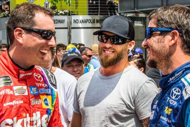 Kyle Busch (left to right), Singer Brantley Gilbert and Martin Truex Jr. chat prior to the start of the 2017 Brantley Gilbert Big Machine Brickyard 400 on July 23 at the Indianapolis Motor Speedway in Indianapolis, Ind. Photo by Edwin Locke/UPI