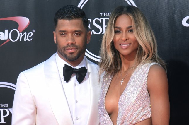 Ciara (R), pictured here with Russell Wilson, said the NFL star surprised her with a private sushi-making lesson on her 31st birthday. File Photo by Jim Ruymen/UPI