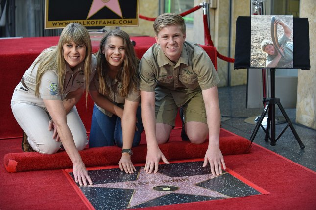 Robert Irwin (R), pictured with Terri Irwin (L) and Bindi Irwin, announced his family's new Animal Planet series was picked up for Season 2. File Photo by Christine Chew/UPI