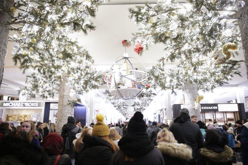 Shoppers walk through Macy's department store in New York City on Black Friday, November 23, 2018. File Photo by John Angelillo/UPI