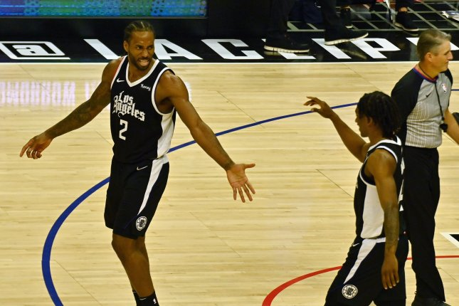 Los Angeles Clippers forward Kawhi Leonard (2) and guard Terance Mann (14) celebrate their Game 7 win against the Dallas Mavericks on Sunday at Staples Center in Los Angeles. Photo by Jim Ruymen/UPI