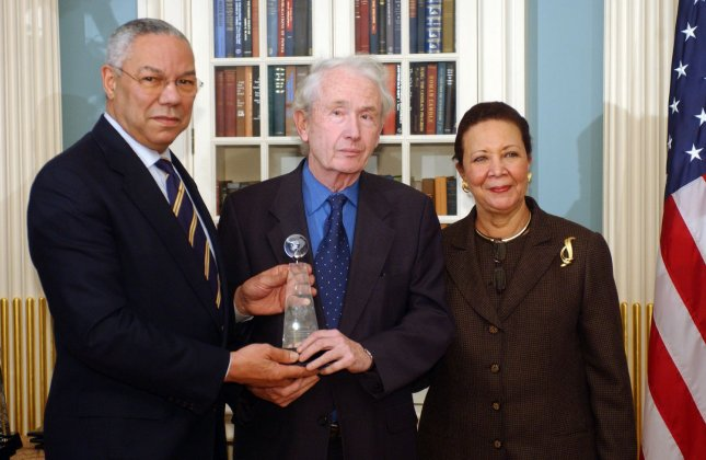 Secretary of State Colin Powell and his wife Alma give writer Frank McCourt an award during a ceremony honoring the 2004 Department of State Cultural Connect Ambassadors at the State Department in Washington on Dec. 13, 2004. (UPI Photo/Roger L. Wollenberg)