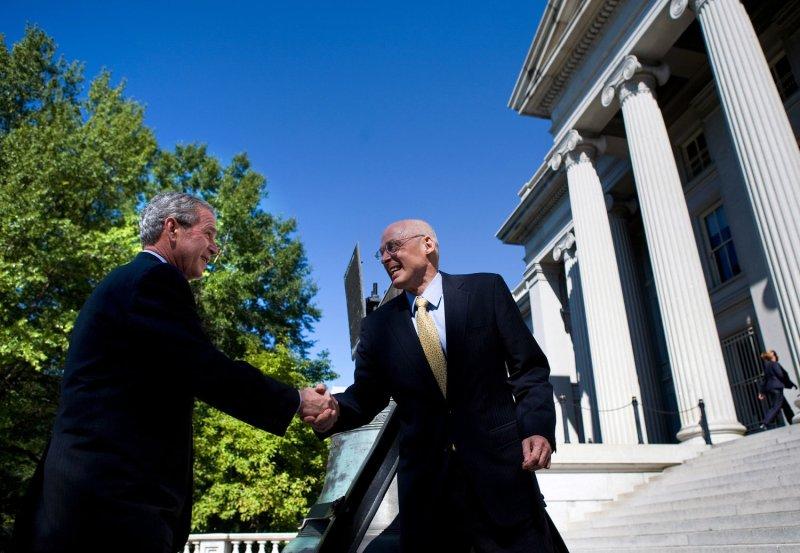U.S. President George W. Bush (L) greets Treasury Secretary Henry Paulson outside the Treasury Department in Washington on October 3, 2008. Congress passed the $700 billion bailout of the financial industry earlier today. (UPI Photo/Brendan Smialowski/POOL)