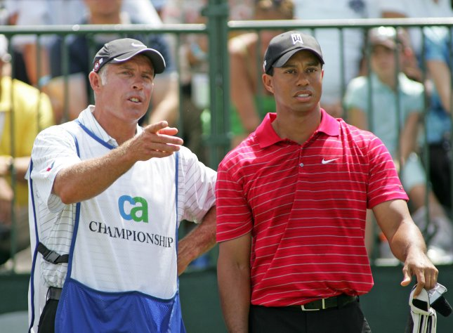 Tiger Woods and his caddy Steve Williams look at the first hole prior to teeing off to start the final round of the World Golf Championships - CA Championship at Doral Country Club in Doral, Florida on March 15, 2009. (UPI Photo/Michael Bush)