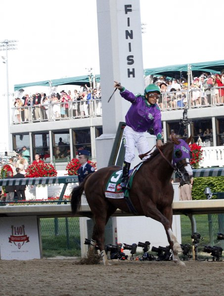 Victor Espinoza, aboard California Chrome, celebrates as they cross the finish line and to win the 140th running of the Kentucky Derby May 3, 2014 in Louisville, KY. UPI /Frank Polich