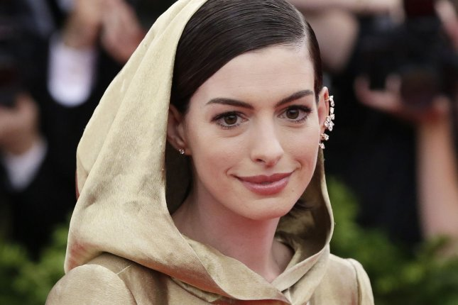 Anne Hathaway arrives on the red carpet at the Costume Institute Benefit at The Metropolitan Museum of Art celebrating the opening of China: Through the Looking Glass in New York City on May 4, 2015. Hathaway, 32, recounted recent run-ins with Hollywood ageism, but said she can't complain because she benefitted from it in her twenties. File Photo by John Angelillo/UPI