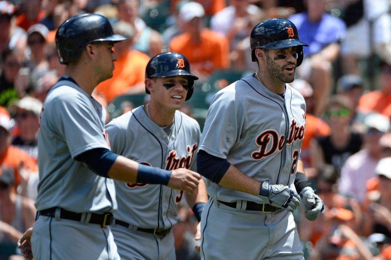 Detroit Tigers' J.D. Martinez (28) leads teammates Jose Iglesias (L) and Ian Kinsler (C). Photo by David Tulis/UPI
