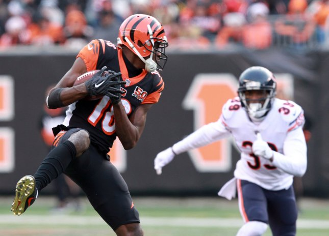 Cincinnati Bengals wide receiver A.J. Green (18) makes the catch under pressure from the Chicago Bearsvdefense during the second half of play at Paul Brown Stadium in Cincinnati, Ohio, December 10, 2017. Photo by John Sommers II /UPI