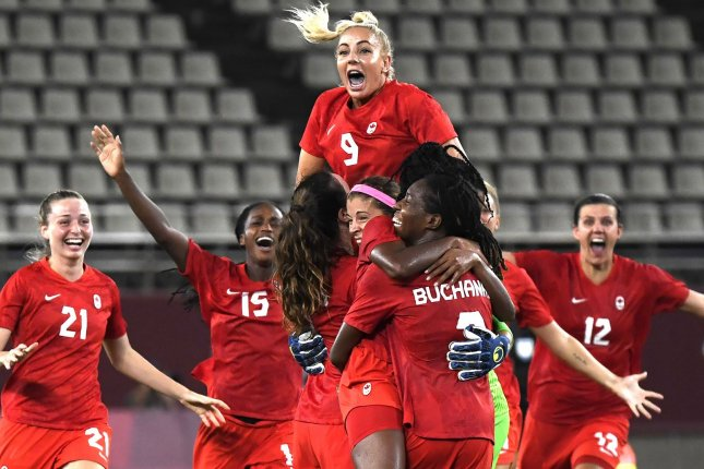 Canada players celebrate a win over the United States in the 2020 Summer Games women's soccer tournament Monday in Kashima, Japan. Photo by Mike Theiler/UPI