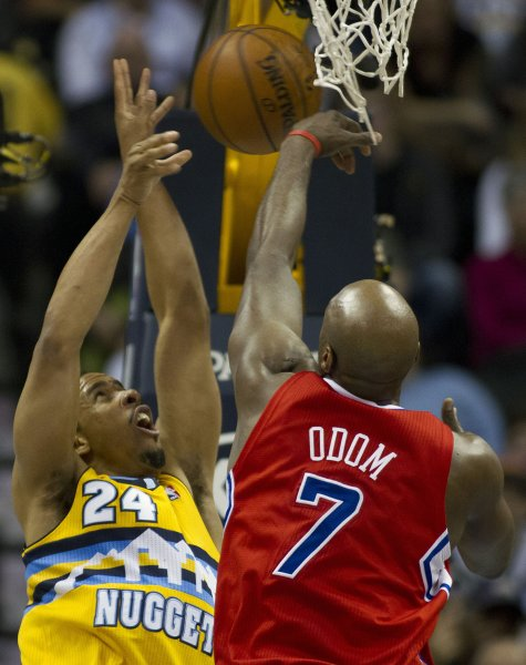 Lamar Odom (7), then with the Los Angeles Clippers, blocks a shot by Denver Nuggets guard Andre Miller at the Pepsi Center in Denver, Jan. 1, 2013. UPI/Gary C. Caskey