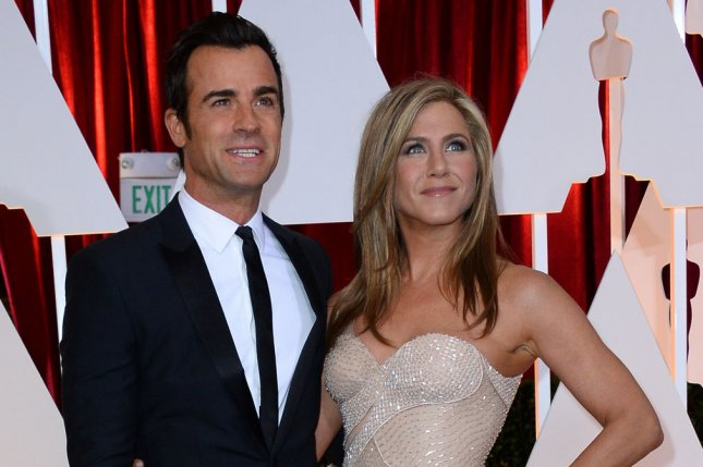 Justin Theroux (L) and Jennifer Aniston arrive at the 87th Academy Awards on February 22, 2015. Aniston penned a piece for the Huffington Post in the over-the-top rumor mongoring of whether or not she is pregnant. She admonished the tabloid media for its constant dogging and for portraying women as less than complete if they are not married with children. File Photo by Jim Ruymen/UPI