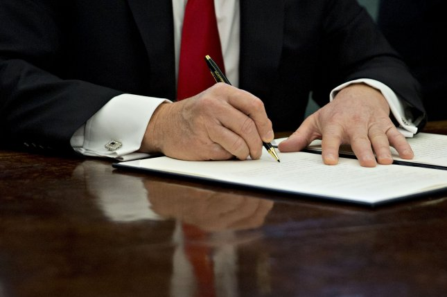 The full text of President Donald Trump's executive order temporarily banning refugees from entering the United States was released by the White House on Monday. Pool Photo by Andrew Harrer/UPI