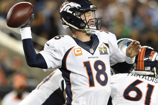 Denver Broncos quarterback Peyton Manning completes a third quarter pass while being protected by Matt Paradis against the Carolina Panthers at Super Bowl 50 at Levi's Stadium in Santa Clara, California on February 7, 2016. Photo by Brian Kersey/UPI