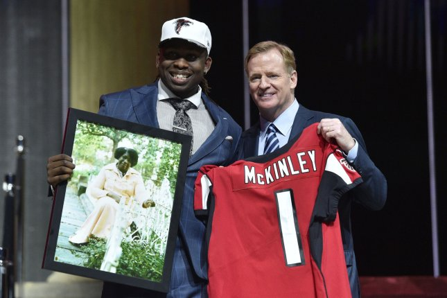 Takkarist McKinley poses for photographs with NFL Commissioner Roger Goodell after being selected by the Atlanta Falcons as the 26th overall pick in the 2017 NFL Draft at the NFL Draft Theater in Philadelphia, PA on April 27, 2017. Photo by Derik Hamilton/UPI
