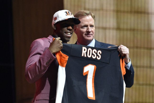 John Ross poses for photographs with NFL Commissioner Roger Goodell after being selected by the Cincinnati Bengals as the ninth overall pick in the 2017 NFL Draft at the NFL Draft Theater in Philadelphia, PA on April 27, 2017. Photo by Derik Hamilton/UPI
