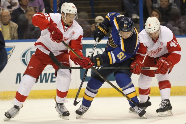 St. Louis Blues Vladimir Tarasenko is tied up by Detroit Red Wings Danny DeKeyser (L) and Luke Glendening in the first period at the Scottrade Center in St. Louis on October 27, 2016. Glendening underwent ankle surgery and is out 3-4 months. File photo by Bill Greenblatt/UPI