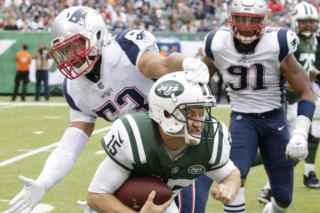 New York Jets quarterback Josh McCown is forced to the ground by New England Patriots linebacker Kyle Van Noy in the second half in Week 6 of the NFL season on October 15, 2017 at MetLife Stadium in East Rutherford, New Jersey. Photo by John Angelillo/UPI