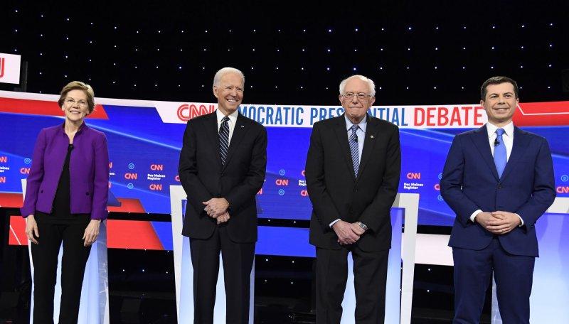 2020 Democratic presidential candidates (L-R) Elizabeth Warren, Joe Biden, Bernie Sanders and Pete Buttigieg gather on stage for a debate in Des Moines, Iowa, on Jan. 14. Photo by Mike Theiler/UPI