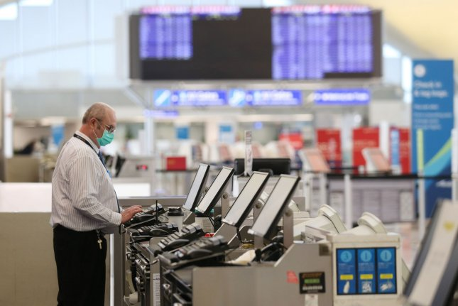 United ticket agent Tim Homann works the counter alone in an near-empty St. Louis-Lambert International Airport on March 28. File Photo by Bill Greenblatt/UPI