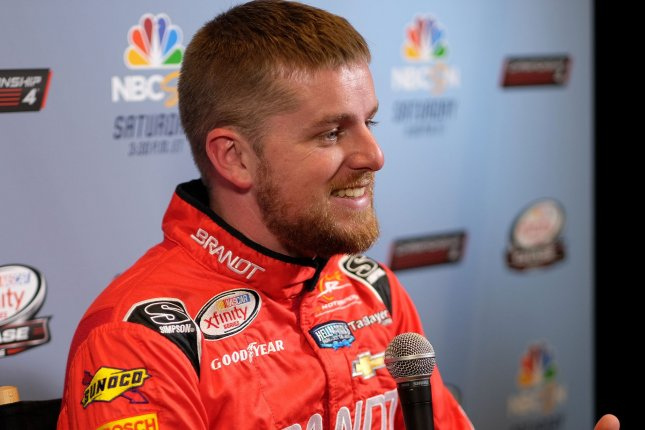 NASCAR's Justin Allgaier will be reevaluated before he is cleared to race again after he was involved in a wreck Thursday at Kentucky Speedway in Sparta. File Photo By Gary I Rothstein/UPI